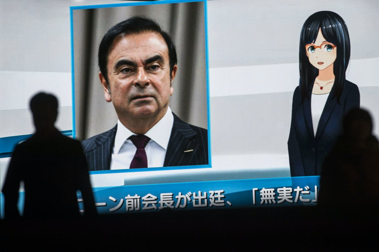 (FILES) In this file photo taken on January 08, 2019 pedestrians pass by a television screen showing a news program featuring former Nissan chief Carlos Ghosn in Tokyo. - A Tokyo court on January 15, 2019 rejected a request for bail for ex-Nissan chief Carlos Ghosn, who faces three charges of financial misconduct and has been detained since November. (Photo by Behrouz MEHRI / AFP)