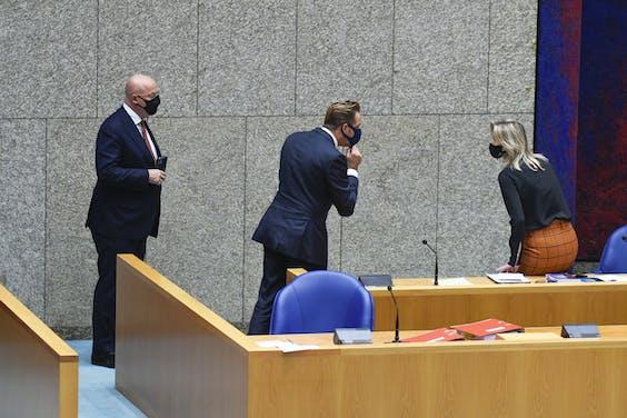 Hugo de Jonge minister van Volksgezondheid, Welzijn en Sport, Kajsa Ollongren, minister van binnenlandse zaken en Koninkrijksrelaties en Ferdinand Grapperhaus Minister van justitie en veiligheid CDA in de Tweede Kamer tijdens een debat over maatregelen ter bestrijding van de corona-epidemie.