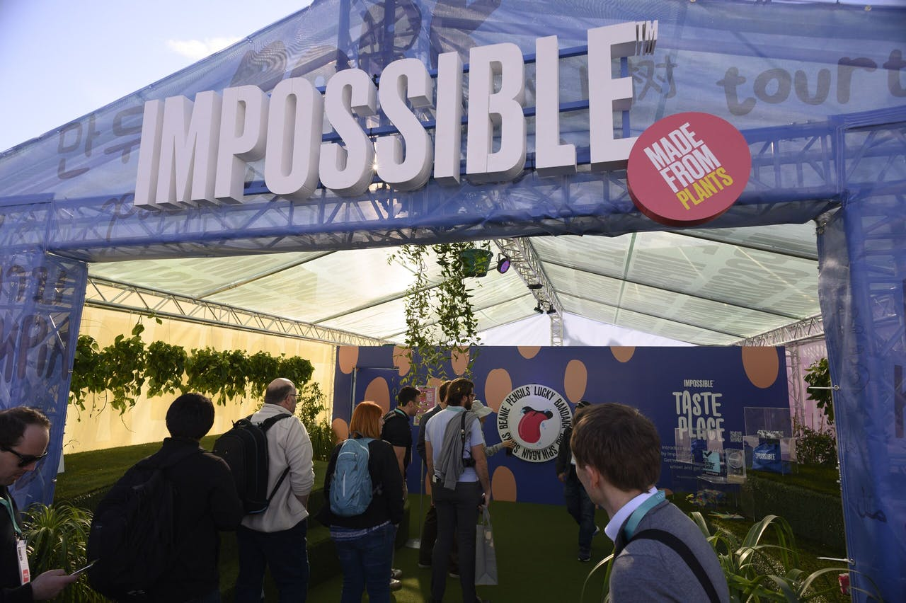 2020-01-08 22:56:21 Attendees visit the Impossible Foods booth, January 8, 2020 at the 2020 Consumer Electronics Show (CES) in Las Vegas, Nevada. Robyn Beck / AFP