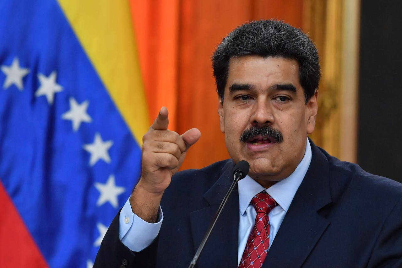 (FILES) In this file photo taken on January 25, 2019 Venezuelan President Nicolas Maduro offers a press conference in Caracas. - Venezuelan President Nicolas Maduro pledged on January 28 to retaliate against the United States for its new sanctions on state oil company PDVSA. (Photo by Yuri CORTEZ / AFP)