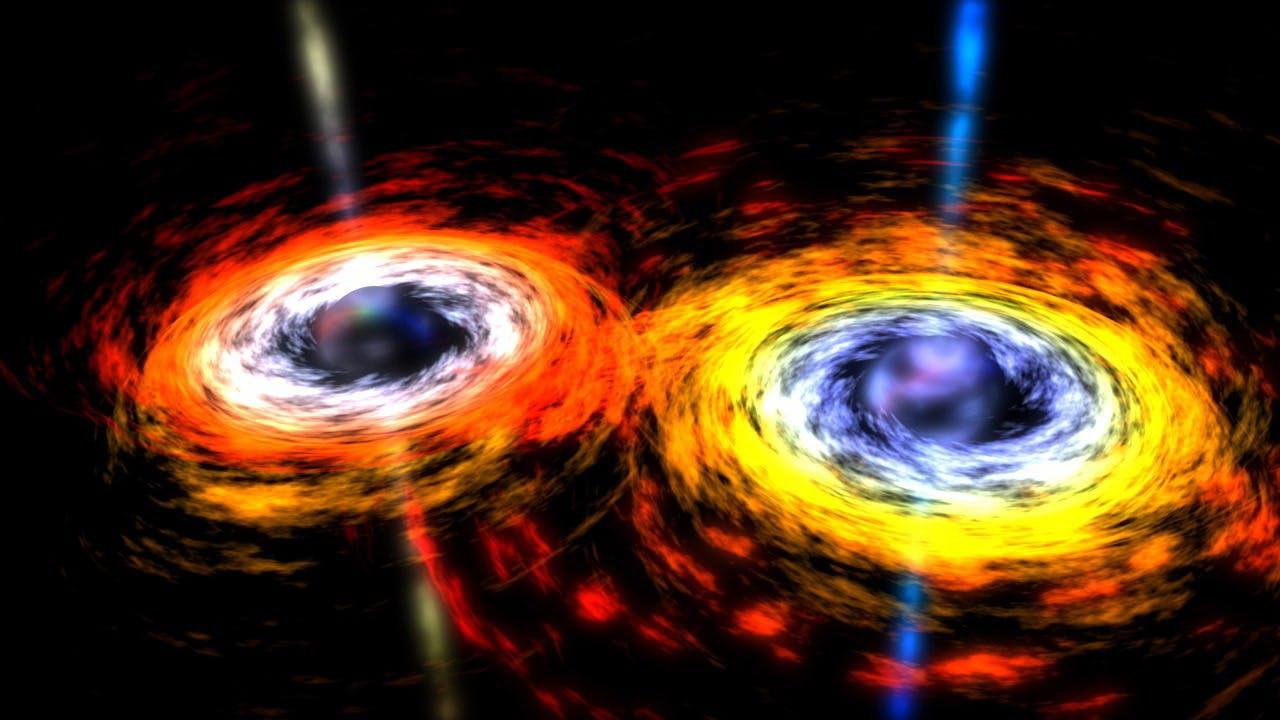 Twee zwarte gaten in een tango van zwaartekracht met elkaar.