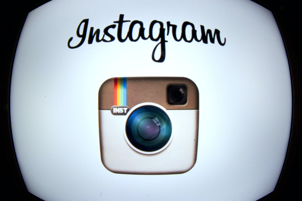 The Instagram logo is displayed on a tablet on December 20, 2012 in Paris. Instagram backed down on December 18, 2012 from a planned policy change that appeared to clear the way for the mobile photo sharing service to sell pictures without compensation, after users cried foul. Changes to the Instagram privacy policy and terms of service set to take effect January 16 had included wording that appeared to allow people's pictures to be used by advertisers at Instagram or Facebook worldwide, royalty-free. AFP PHOTO / LIONEL BONAVENTURE (Photo by LIONEL BONAVENTURE / AFP)