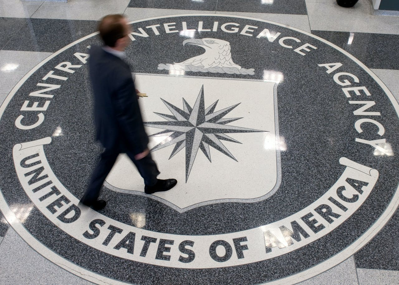 A man crosses the Central Intelligence Agency (CIA) seal in the lobby of CIA Headquarters in Langley, Virginia, on August 14, 2008. AFP PHOTO/SAUL LOEB (Photo by SAUL LOEB / AFP)