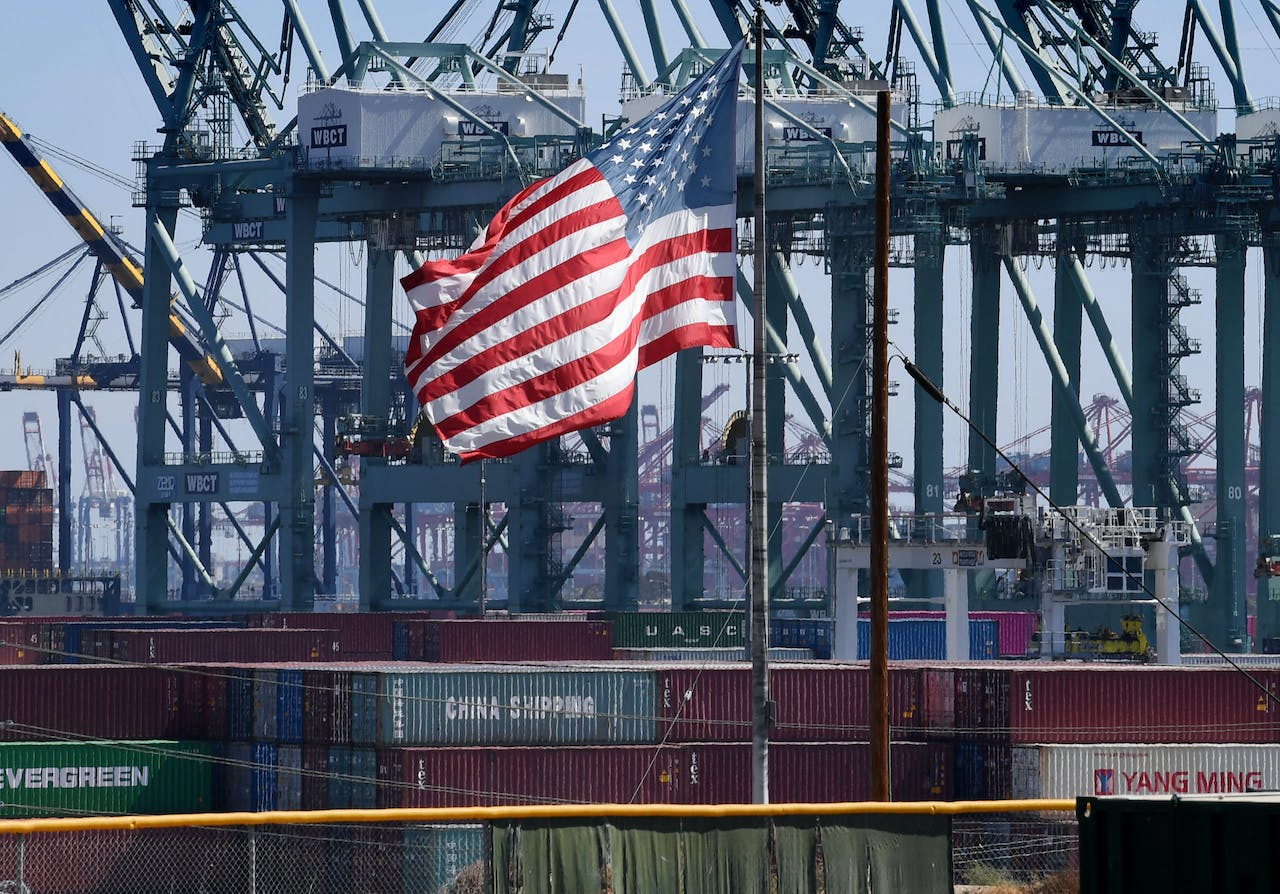 "2018-09-29 13:39:39 The US flag flies over Chinese shipping containers that were unloaded at the Port of Long Beach, in Los Angeles County, on September 29, 2018. President Donald Trump insisted that there had been ""absolutely no impact"" on the US economy from the escalating trade dispute between his administration and China. ""We have to make it fair. So we're at $250 billion now, 25 percent interest,"" he said in reference to a package of tariffs imposed on Chinese imports. Mark RALSTON / AFP"