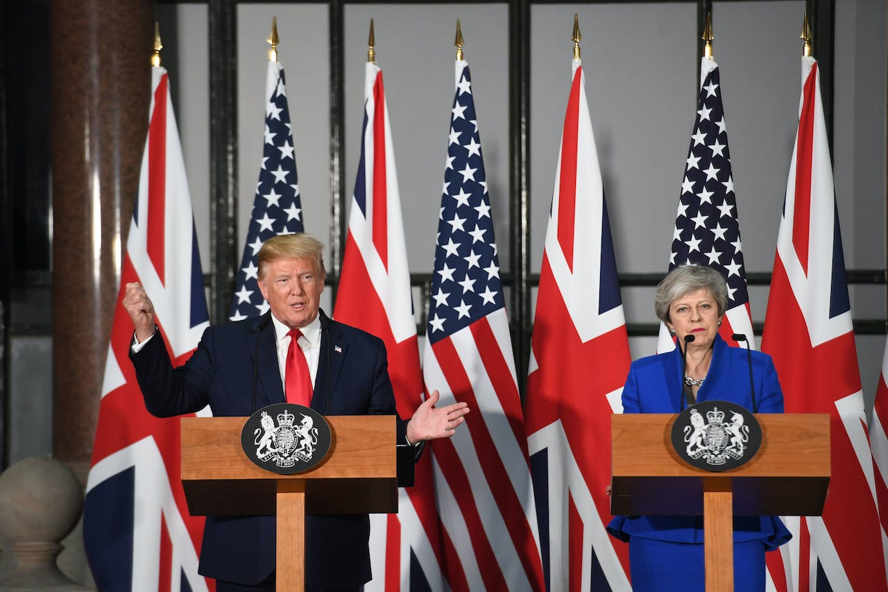 US President Donald Trump (L) speaks as Britain's Prime Minister Theresa May (R) listens during a joint press conference at the Foreign and Commonwealth Office (FCO) in central London on June 4, 2019, on the second day of the US president's three-day State Visit to the UK. - US President Donald Trump turns from pomp and ceremony to politics and business on Tuesday as he meets Prime Minister Theresa May on the second day of a state visit expected to be accompanied by mass protests. (Photo by Stefan Rousseau / POOL / AFP)