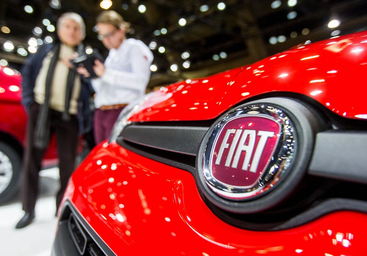 2017-01-16 13:41:27 epa06473651 (FILE) - A company logo at a Fiat car presented at the Brussels Motor Show in Brussels, Belgium, 16 January 2017. FCA, Fiat Chrysler Automobiles, on 25 January 2018 released their full year 2017 and fourth quarter results, saying FCA had annual record results with adjusted EBIT up 16 per cent to 7,1 billion euro, and adjusted net profit up 50 per cent to 3,8 billion euro. FCA also said all company segments enjoyed a continued profitability and a year-over-year improvement. EPA/STEPHANIE LECOCQ